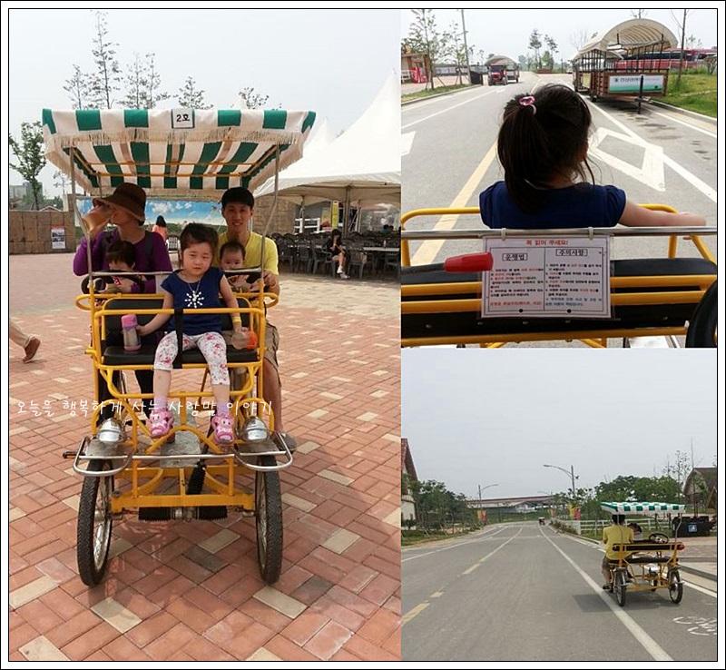 자전거를 타고 있는 아이의 뒷 모습, 자전거를 타고 자전거 도로를 주행하는 모습, 자전거에 올라탄 가족의 모습