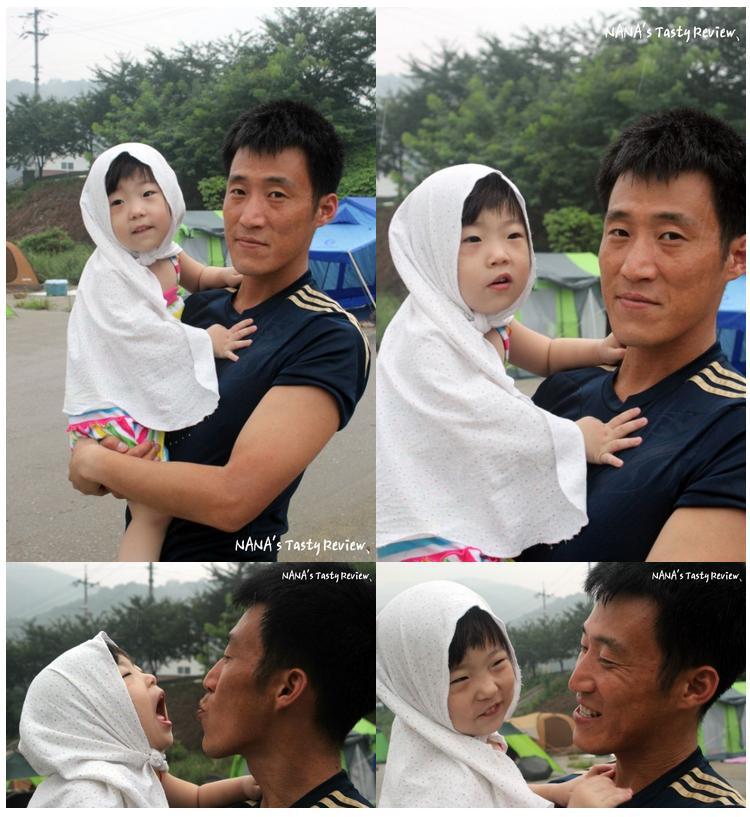 아빠가 딸을 안고 있는 사진
